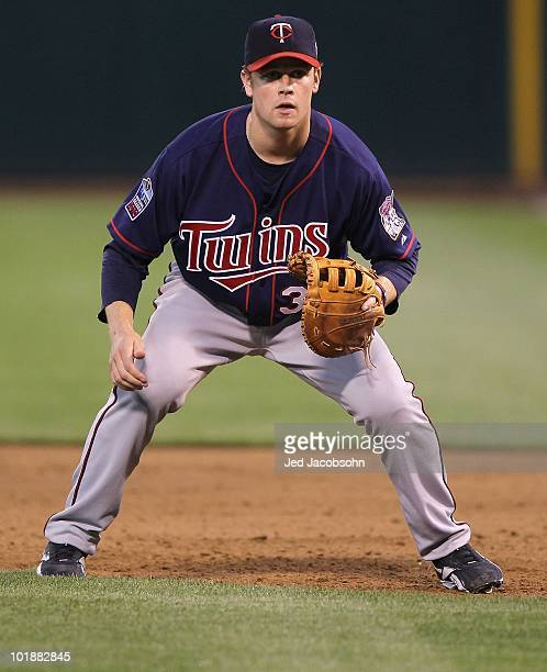 Justin Morneau of the Minnesota Twins plays at first base against the Oakland Athletics during an MLB game at the OaklandAlameda County Coliseum on...