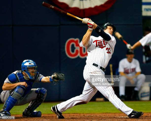 Justin Morneau of the Minnesota Twins strikes out in the seventh inning in a game against the Kansas City Royals at the Metrodome on September 28...