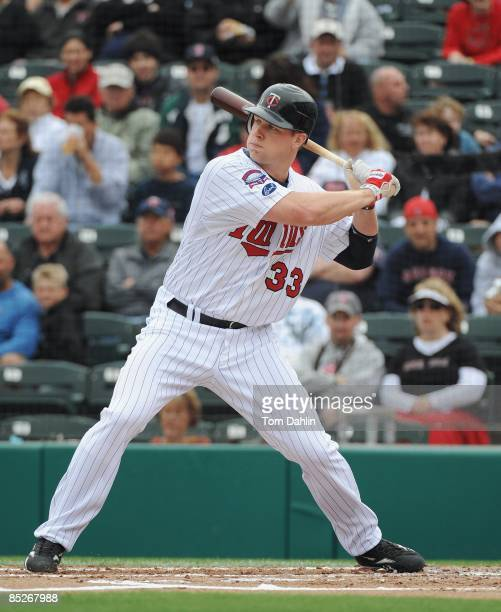 Justin Morneau of the Minnesota Twins waits for a pitch during a Grapefruit League Spring Training Game against the Boston Red Sox at Hammond Stadium...