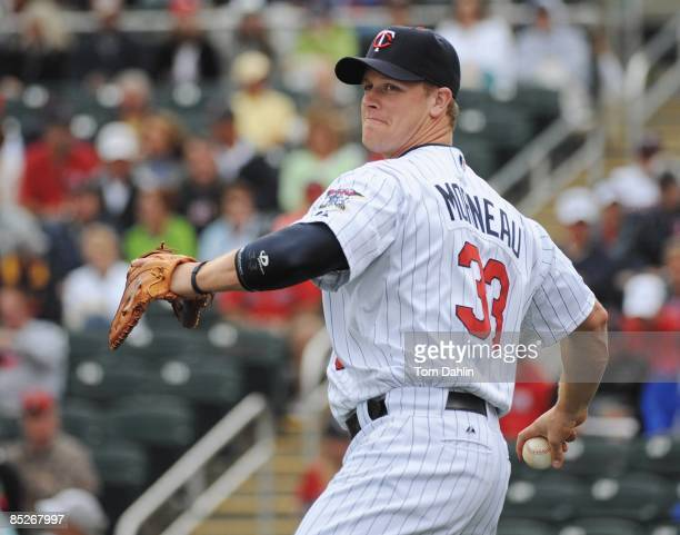 Justin Morneau of the Minnesota Twins warms up prior to a Grapefruit League Spring Training Game against the Boston Red Sox at Hammond Stadium on...