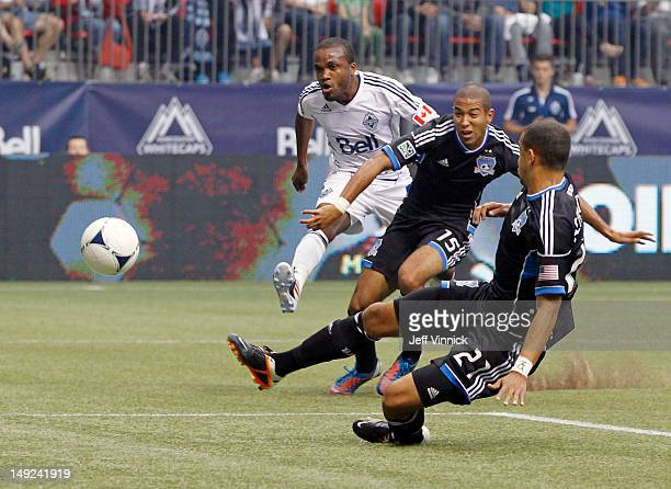 Justin Morrow and Cesar Diaz Pizarro of the San Jose Earthquakes look on as Dane Richards of the Vancouver Whitecaps FC kicks the ball for a...