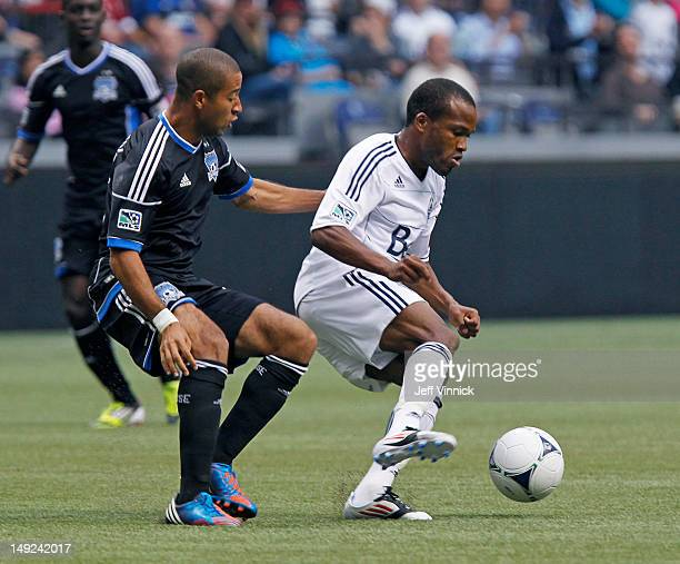 Justin Morrow of the San Jose Earthquakes and Dane Richards of the Vancouver Whitecaps FC battle for the ball during their MLS game July 22 2012 at...