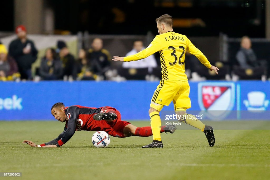 Justin Morrow #2 of the Toronto FC is knocked down by Pedro Santos #32 of the Columbus Crew SC while battling for control of a loose ball during the first half at MAPFRE Stadium on November 21, 2017 in Columbus, Ohio.