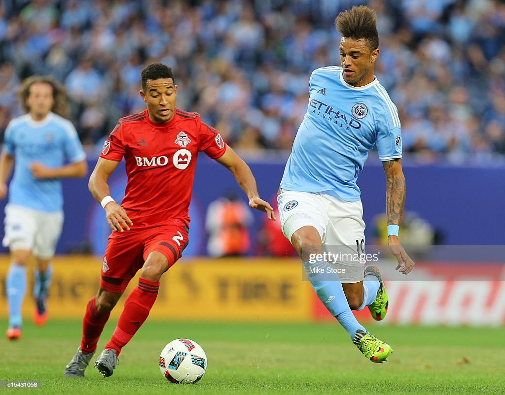 Justin Morrow #2 of Toronto FC and Khiry Shelton #19 of New York City FC pursue the ball at Yankee Stadium on March 13, 2016 in the Bronx borough of New York City.