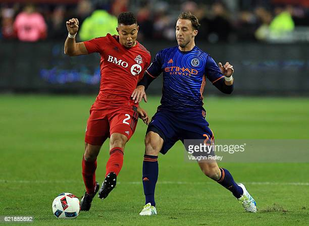 Justin Morrow of Toronto FC battles for the ball with RJ Allen of New York City FC during the second half of an MLS Conference semifinal playoff game...