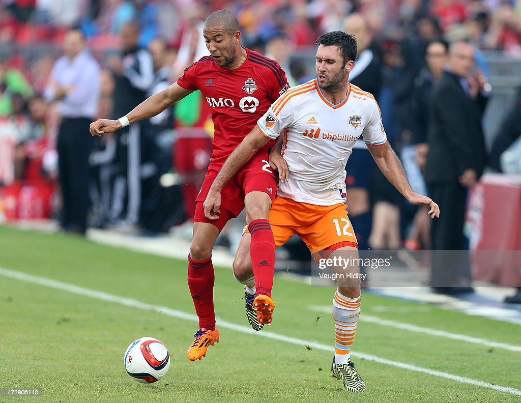Justin Morrow #2 of Toronto FC battles with Will Bruin #12 of the Houston Dynamo during an MLS soccer game between the Houston Dynamo and Toronto FC at BMO Field on May 10, 2015 in Toronto, Ontario, Canada.