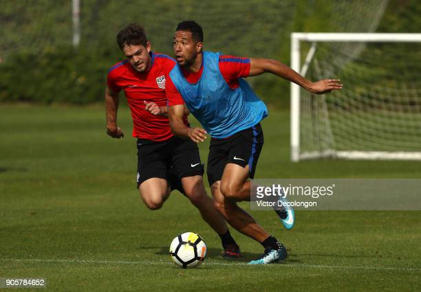 Justin Morrow plays the ball forward as Kelyn Rowe keeps pace during the US Men's National Soccer Team training session at StubHub Center on January...