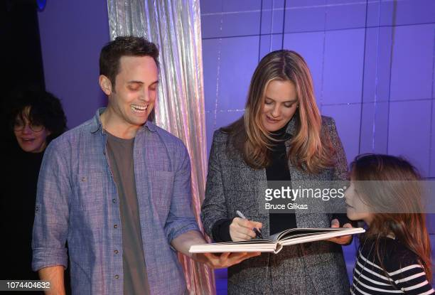 Justin Mortelliti and Alicia Silverstone who is signing his yearbook backstage at The New Group production of 'Clueless The Musical' based on the...