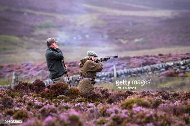 Justin Muir takes a shot on first day of the grouse shooting season on Forneth Moor on August 13, 2018 in Dunkeld, Scotland. Gamekeepers are...