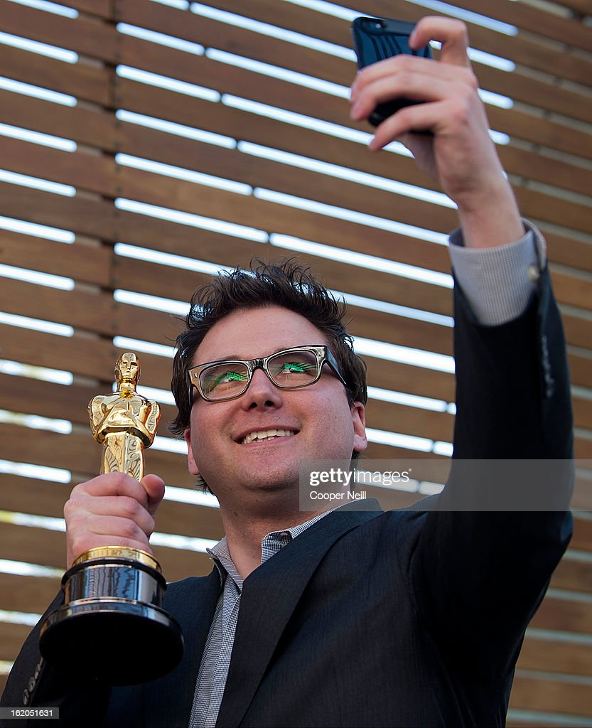Justin Muller poses with an Oscar trophey during First-Ever Oscar Roadtrip at the Angelika Film Center on February 18, 2013 in Dallas.