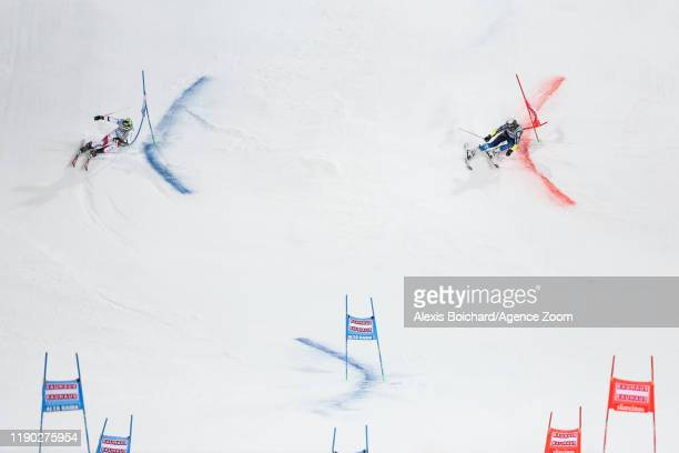 Justin Murisier of Switzerland Mattias Roenngren of Sweden compete during the Audi FIS Alpine Ski World Cup Men's Parallel Giant Slalom on December...