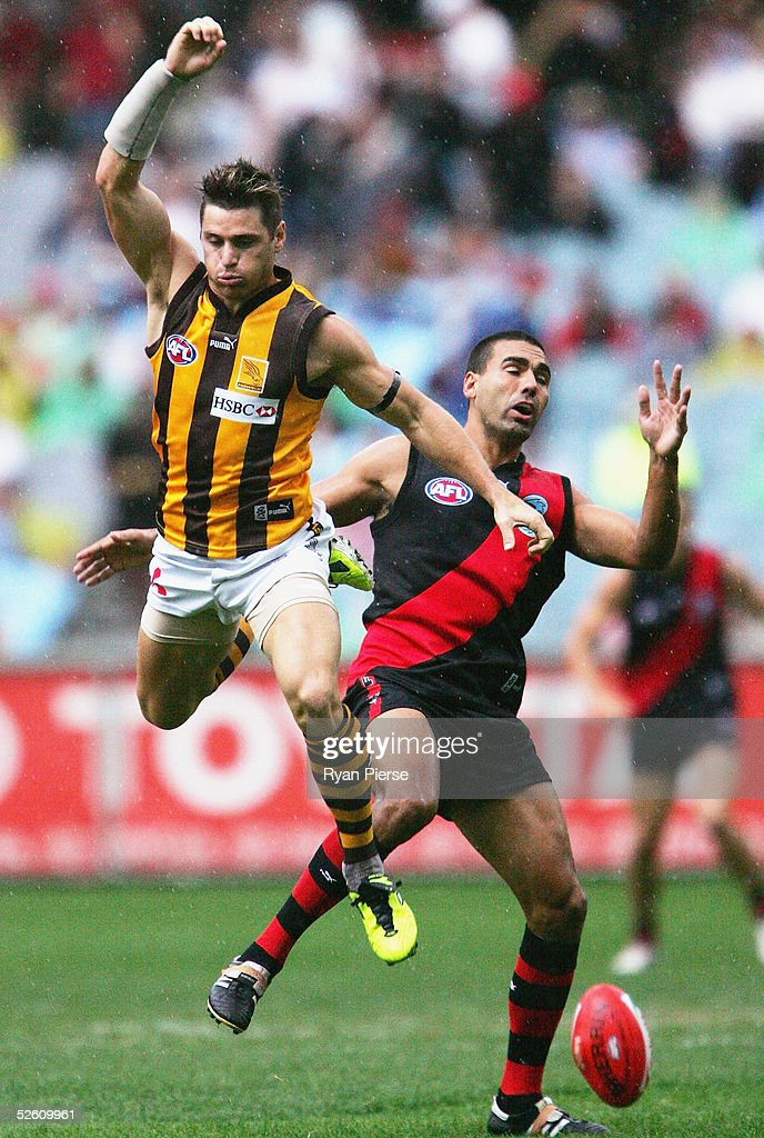 Justin Murphy #28 for the Bombers competes for the ball against Shane Crawford #9 for the Hawks during the round three AFL match between the Essendon Bombers and the Hawthorn Hawks at the M.C.G. on April 10, 2005 in Melbourne, Australia.