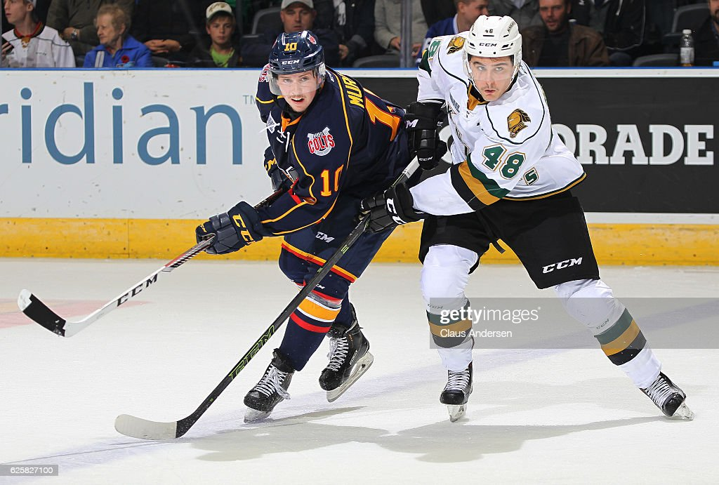 Justin Murray #10 of the Barrie Colts skates against Sam Miletic #48 of the London Knights during an OHL game at Budweiser Gardens on November 25, 2016 in London, Ontario, Canada. The Knights defeated the Colts 4-1.
