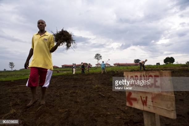 Justin Mutangana helps till the land inside the Agahozo Shalom Youth Village on March 11 2009 in Rwamagana Rwanda The ASYV provides food shelter...