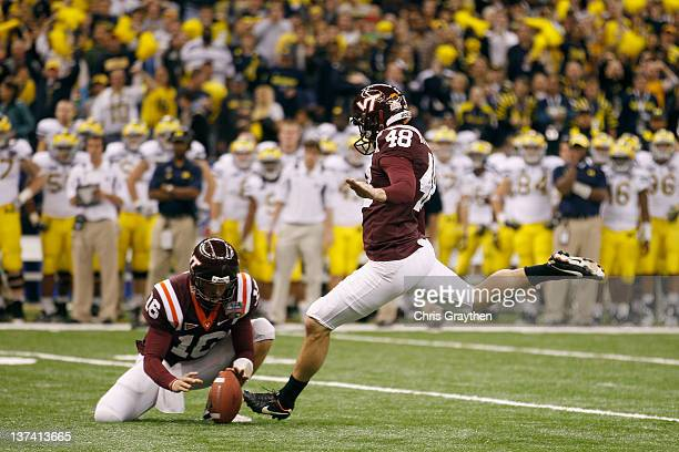 Justin Myer of the Virginia Tech Hokies misses a field goal attempt in overtime from the hold of Trey Gresh against the Michigan Wolverines during...