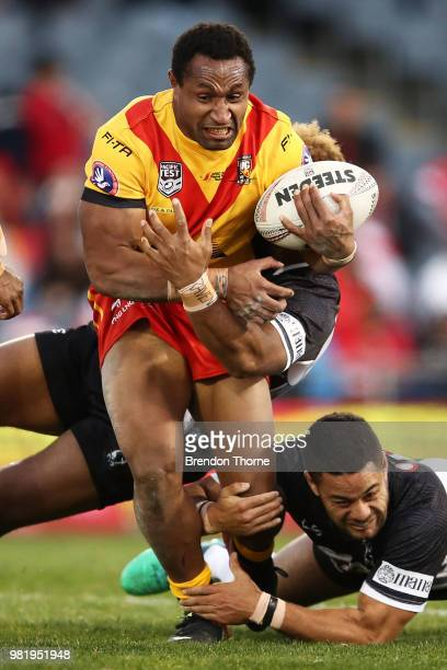 Justin Olam of PNG is tackled by the Fijian defence during the 2018 Pacific Test Invitational match between Fiji and Papua New Guinea at Campbelltown...
