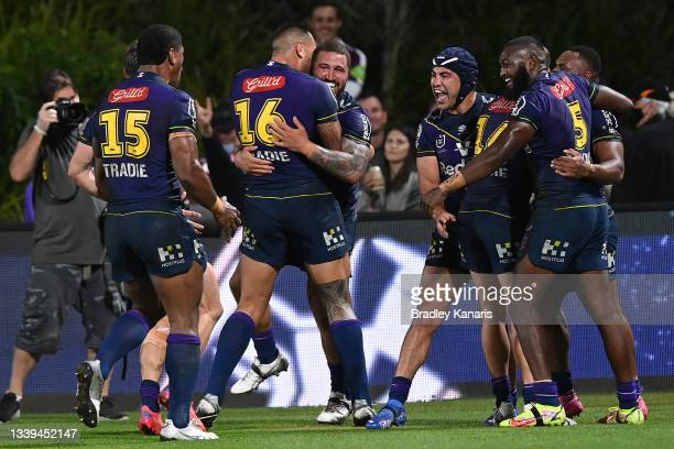 Justin Olam of the Storm celebrates with team mates after scoring a try during the NRL Qualifying Final between the Melbourne Storm and the Manly...