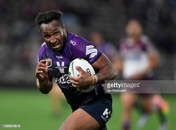 Justin Olam of the Storm runs to score a try during the round 16 NRL match between the Melbourne Storm and the Manly Sea Eagles at Sunshine Coast...