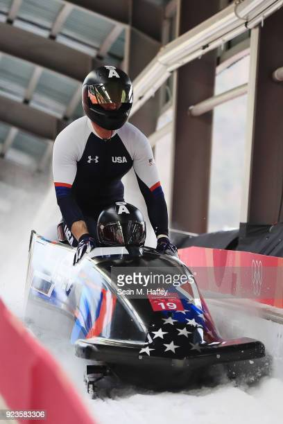 Justin Olsen Nathan Weber Carlo Valdes and Christopher Fogt of the United States react in the finish area during 4man Bobsleigh Heats on day fifteen...