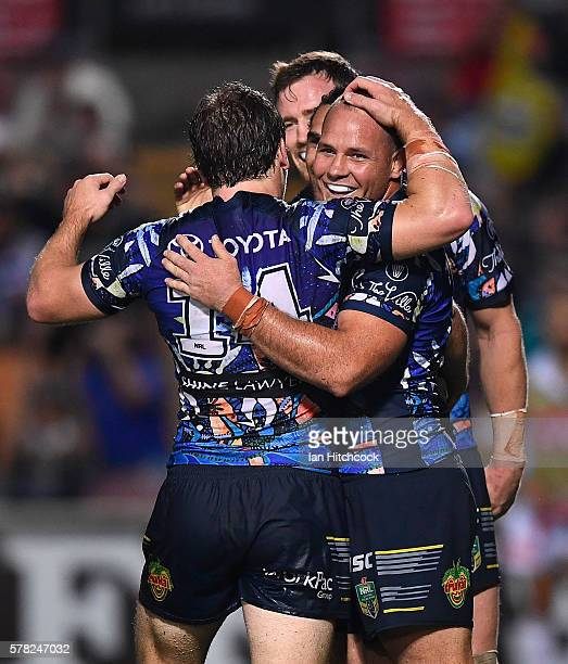 Justin O'Neil of the Cowboys celebrates after scoring a try with Matthew Scott Rory Kostjasyn and Gavin Cooper of the Cowboys during the round 20 NRL...