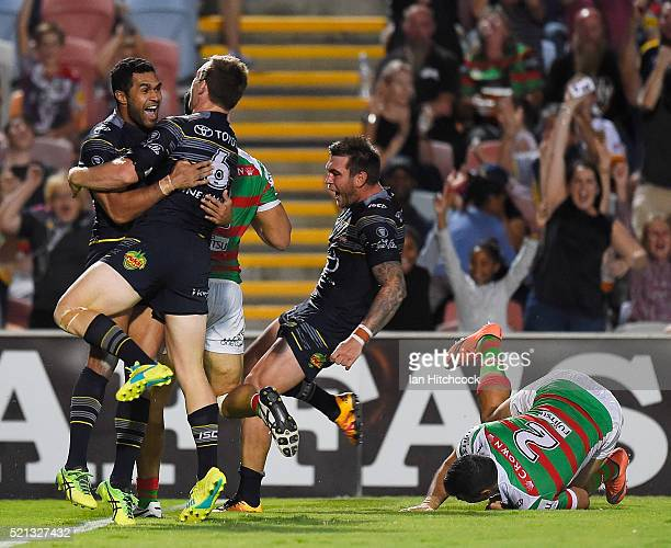 Justin O'Neil of the Cowboys celebrates with Michael Morgan of the Cowboys after scoring a try during the round seven NRL match between the North...