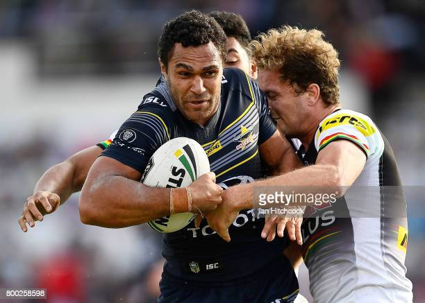 Justin O'Neil of the Cowboys is tackled by Matthew Moylan of the Panthers during the round 16 NRL match between the North Queensland Cowboys and the...