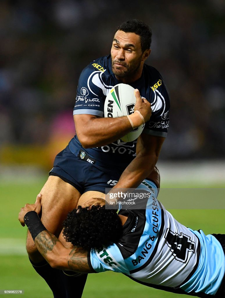 Justin O'Neil of the Cowboys is tackled by Ricky Leutele of the Sharks during the round one NRL match between the North Queensland Cowboys and the Cronulla Sharks at 1300SMILES Stadium on March 9, 2018 in Townsville, Australia.
