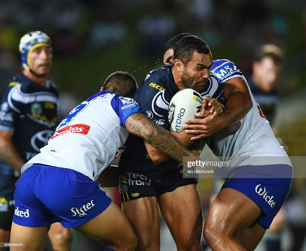 Justin O'Neil of the Cowboys is tackled during the round six NRL match between the North Queensland Cowboys and the Canterbury Bulldogs at 1300SMILES Stadium on April 14, 2018 in Townsville, Australia.