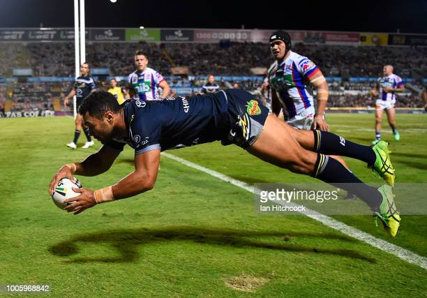 Justin O'Neil of the Cowboys scores a try during the round 20 NRL match between the North Queensland Cowboys and the Newcastle Knights at 1300SMILES...