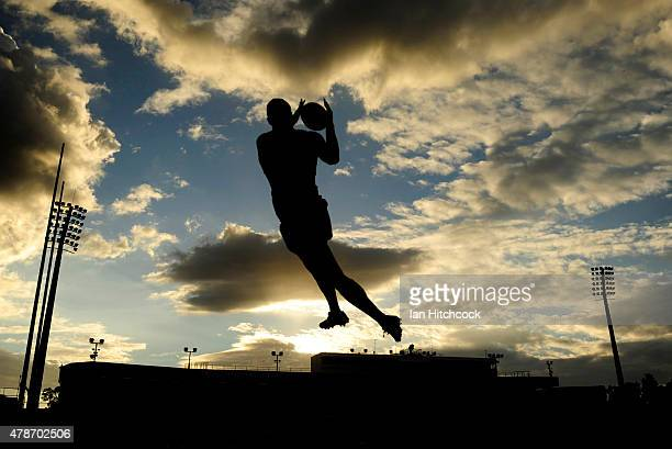 Justin O'Neil of the Cowboys takes a high ball during the warm up before the start of the round 16 NRL match between the North Queensland Cowboys and...