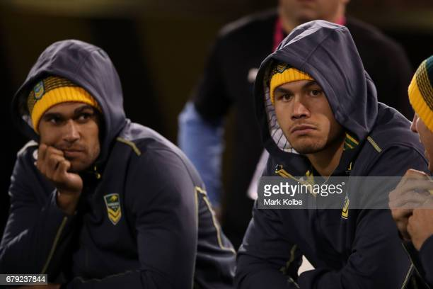 Justin O'Neill and Jordan McLean watch on from the sideline during the ANZAC Test match between the Australian Kangaroos and the New Zealand Kiwis at...