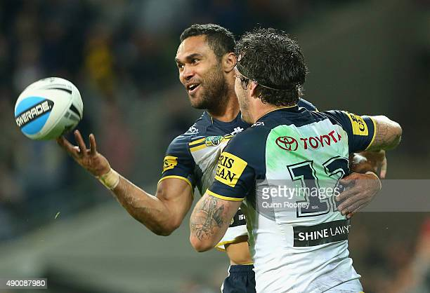 Justin O'Neill of the Cowboys is congratulated by Ethan Lowe after scoring a try during the NRL Second Preliminary Final match between the Melbourne...