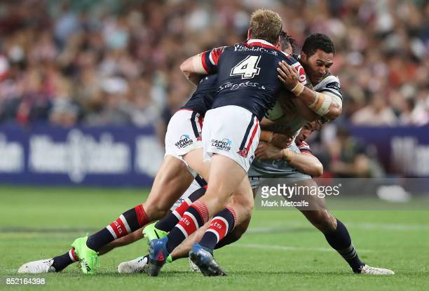Justin O'Neill of the Cowboys is tackled during the NRL Preliminary Final match between the Sydney Roosters and the North Queensland Cowboys at...