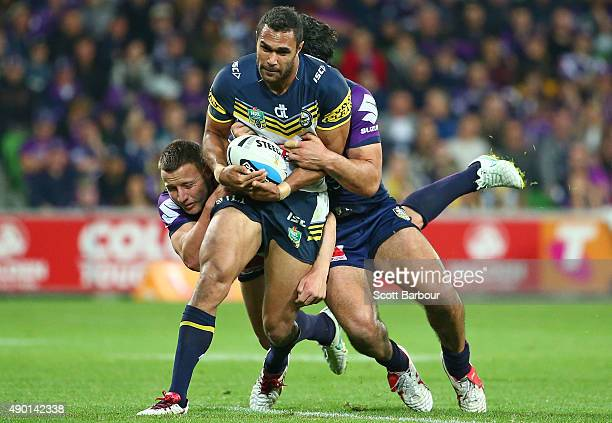 Justin O'Neill of the Cowboys is tackled during the NRL Second Preliminary Final match between the Melbourne Storm and the North Queensland Cowboys...