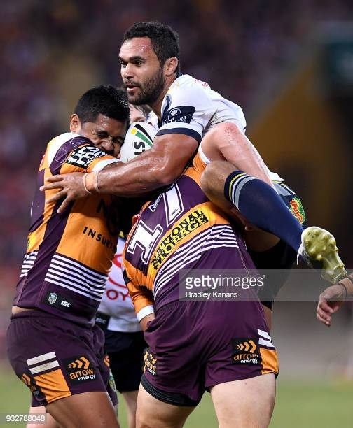 Justin O'Neill of the Cowboys is tackled during the round two NRL match between the Brisbane Broncos and the North Queensland Cowboys at Suncorp...