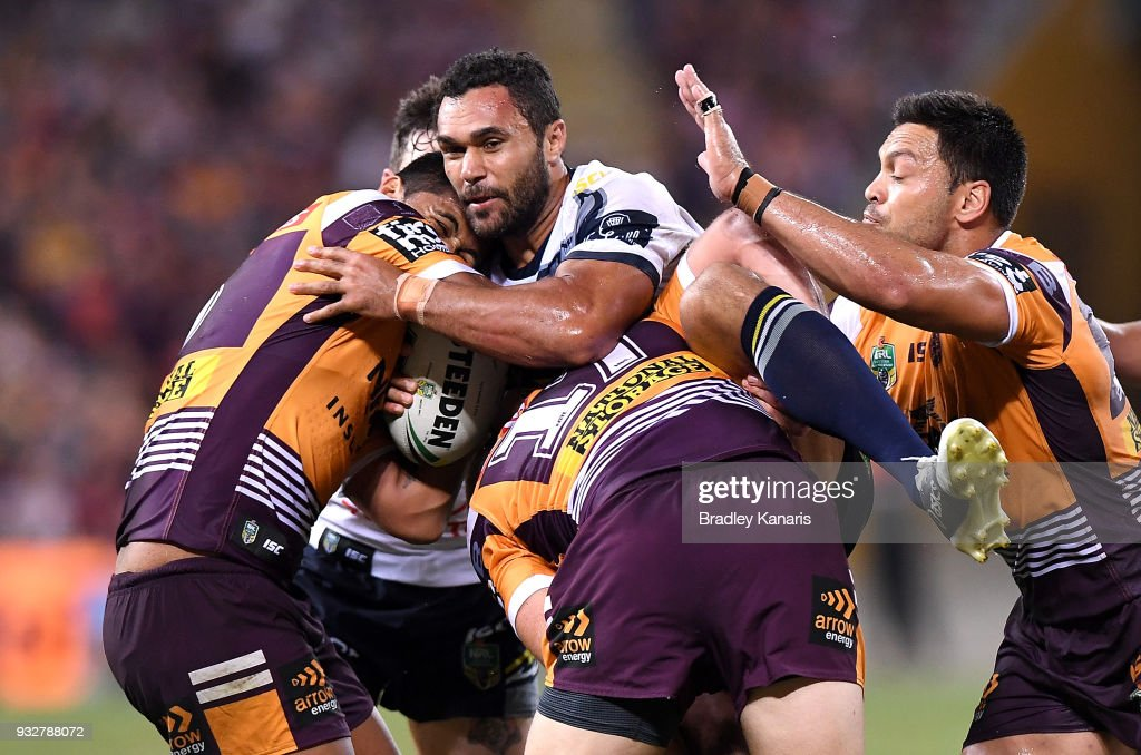 Justin O'Neill of the Cowboys is tackled during the round two NRL match between the Brisbane Broncos and the North Queensland Cowboys at Suncorp Stadium on March 16, 2018 in Brisbane, Australia.