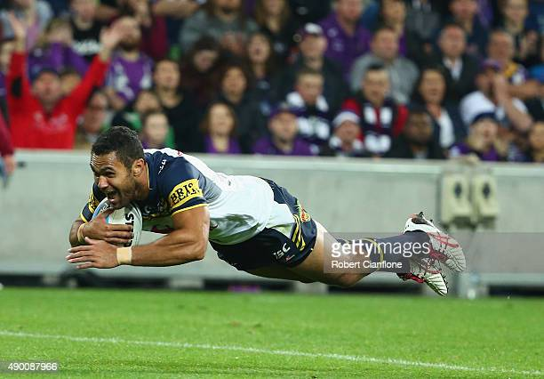 Justin O'Neill of the Cowboys scores a try during the NRL Second Preliminary Final match between the Melbourne Storm and the North Queensland Cowboys...