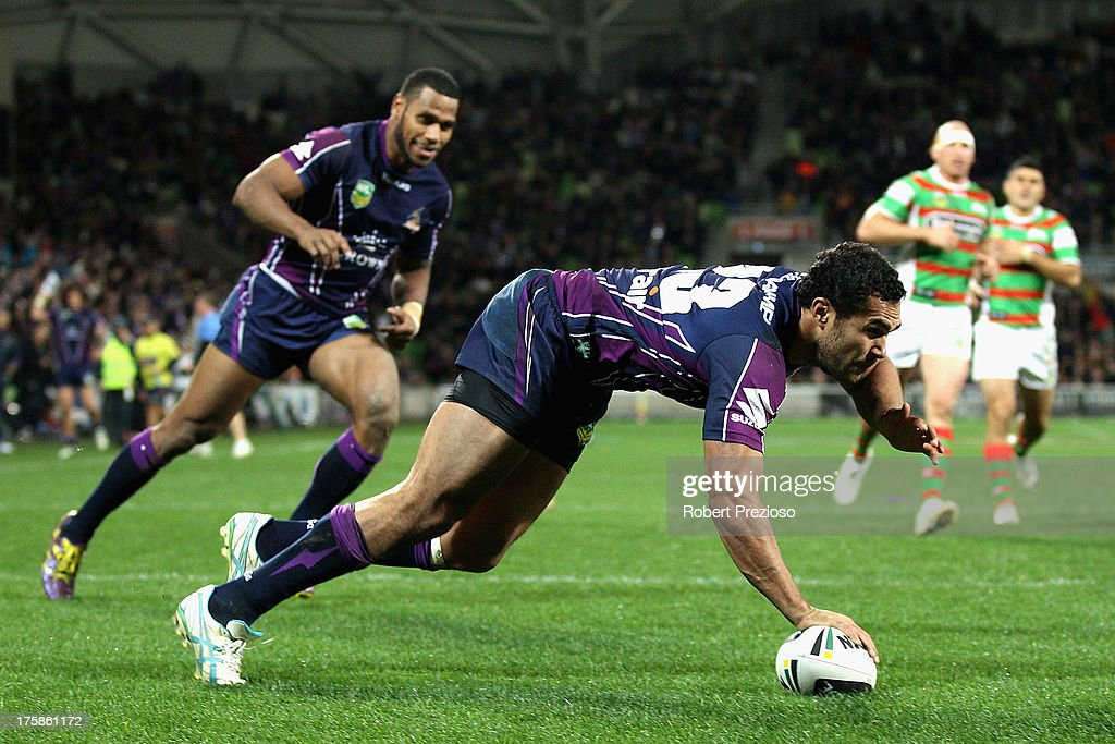 Justin O'Neill of the Storm crosses the line to score a try during the round 22 NRL match between the Melbourne Storm and the South Sydney Rabbitohs at AAMI Park on August 9, 2013 in Melbourne, Australia.