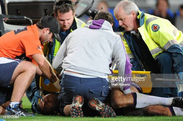 Justin O'Neill of the Storm receives medical attention on the field after being injured in a tackle during the round 23 NRL match between the Gold...