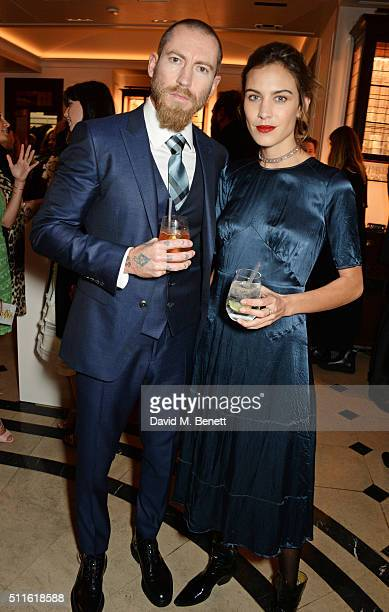 Justin O'Shea and Alexa Chung attend as mytheresacom and Burberry celebrate the new MYT Woman at Thomas's on February 21 2016 in London England