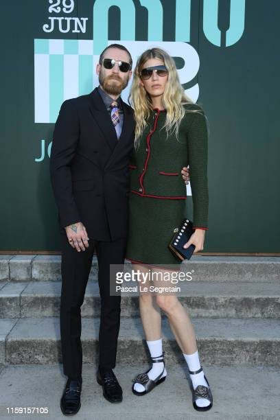 Justin O'Shea and Veronika Heilbrunner attend miu miu club event at Hippodrome d'Auteuil on June 29 2019 in Paris France