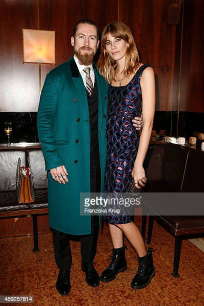 Justin O'Shea and Veronika Heilbrunner attend the mytheresacom X Burberry Dinner on November 19 2014 in Munich Germany