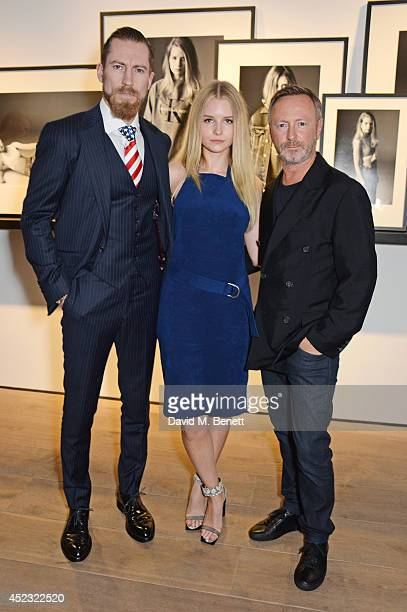Justin O'Shea Buying Director of Mytheresacom Lottie Moss and Kevin Carrigan Global Creative Director of Calvin Klein Jeans attend the Calvin Klein...