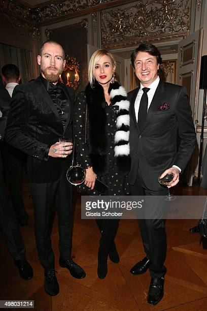 Justin O'Shea Princess Elisabeth von Thurn und Taxis and shoe designer Gianvito Rossi pose during the mytheresacom X Gianvito Rossi dinner at St...
