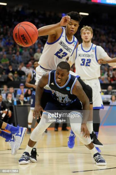 Justin Patton of the Creighton Bluejays battles for the ball with Jared Terrell of the Rhode Island Rams during the first round of the 2017 NCAA...