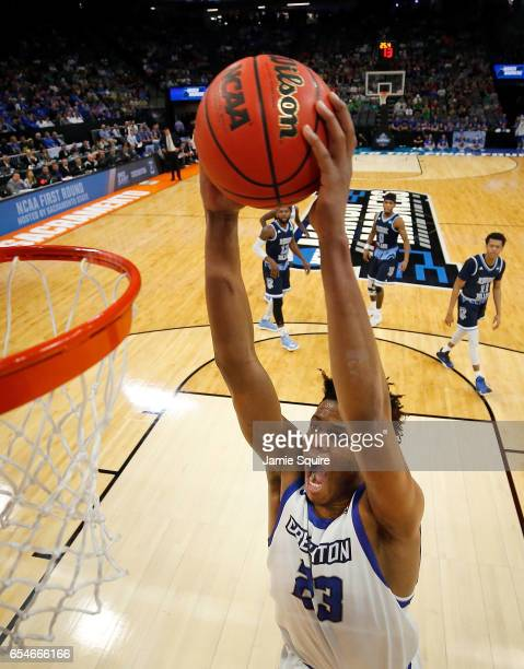 Justin Patton of the Creighton Bluejays dunks during the first round of the NCAA Basketball Tournament against the Rhode Island Rams at Golden 1...