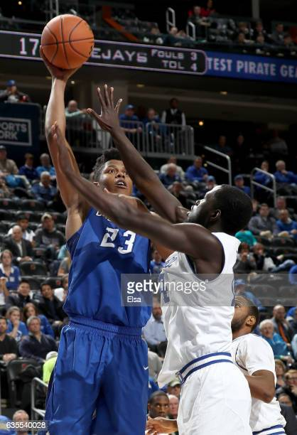 Justin Patton of the Creighton Bluejays takes a shot as Ismael Sanogo of the Seton Hall Pirates defends on February 15 2017 at Prudential Center in...