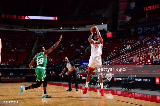 Justin Patton of the Houston Rockets shoots the ball during the game against the Boston Celtics on March 14, 2021 at the Toyota Center in Houston,...