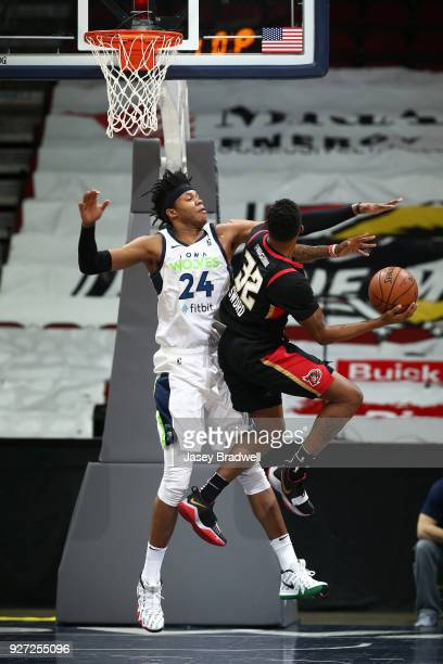Justin Patton of the Iowa Wolves contests the shot by Craig Sword of the Erie BayHawks during the NBA GLeague on March 4 2018 at the Wells Fargo...