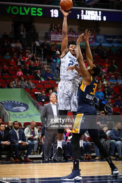Justin Patton of the Iowa Wolves shoots over Asauhn DixonTatum of the Salt Lake City Stars in an NBA GLeague game on December 8 2017 at the Wells...